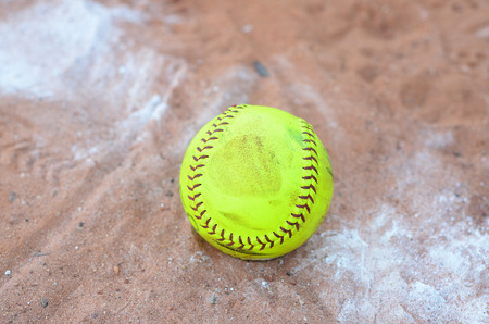 mit: old softball in field Stock Photo
