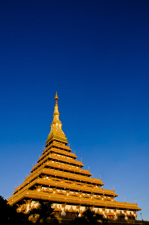 khon: Thailand Bhudda temple golden Stupa Khonkaen landmark,Temple against blue sky in Khon Kaen, Thailand; Wat Nong Waeng (Temple), Stock Photo