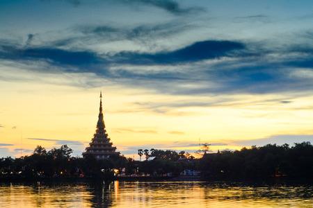 Thailand Bhudda temple golden Stupa Khonkaen landmark,Temple Sunset  in Khon Kaen, Thailand; Wat Nong Waeng (Temple),