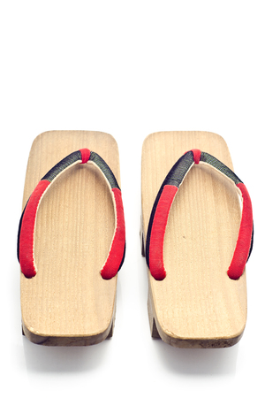 Geta is a traditional footwear of Japan.old geta on White background Stock Photo