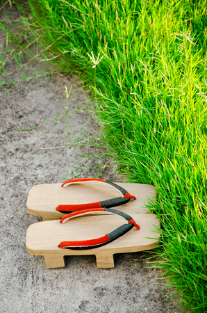 space to write: Traditional Japanese Geta slippers.Pair of old Japanese Sandals - Geta Japanese Geta sandals are a form of traditional Japanese footwear.have space write words.