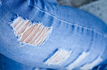 Jeans background texture,Denim jeans texture or denim jeans background with old torn. Old grunge vintage denim jeans. Stitched texture denim jeans background of fashion jeans design. Dark edged. Stock Photo