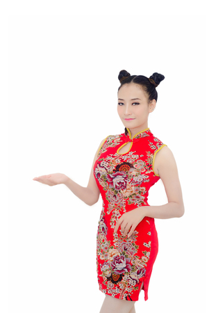 happy Chinese new year. Asian girl with gesture of congratulation on White background Stock Photo