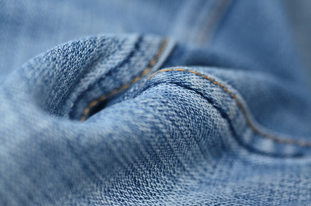 Jeans background texture,Blank real leather jeans label sewed on old worn jeans. Stock Photo