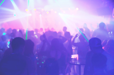 blur Light in club party Show And Silhouette of audience crowd people  enjoying the club party with concert. Blurry night club DJ party people enjoy of music dancing sound