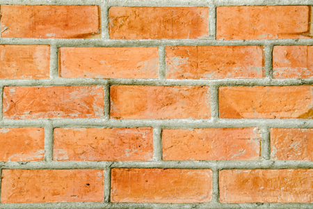 Brick wall background. Texture of a brick wall close-up.