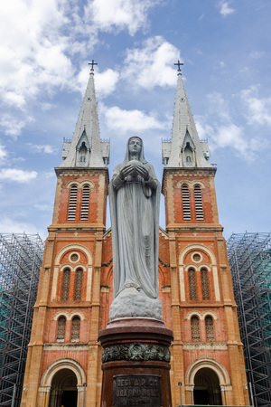 The Virgin Mary statue and exterior of Saigon Notre Dame Cathedral Basilica in Ho Chi Minh city, Vietnam. Asia