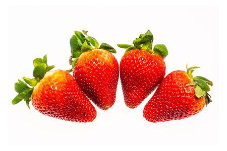 four strawberry isolated on white background. The fruit is not yet ripe. Foto de archivo - 130261492