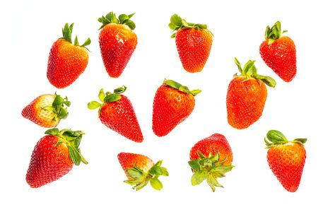 Strawberry group isolated on white background. The fruit is not yet ripe. 写真素材