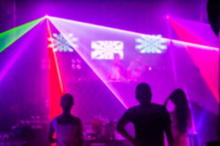 Abstract blur Light And Silhouette in club party is blurred for background