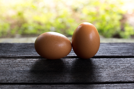 to maintain: Eggs on wood are menu for breakfast,Silhouette of egg concept Stock Photo