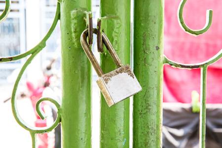 Old lock pad locked on fence