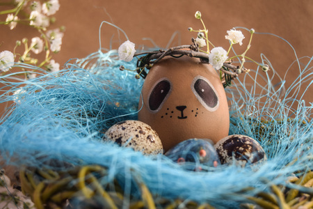 Easter holiday concept with cute handmade eggs, rabbit, chicks, owl, panda and deer. Creative eggs for Easter. Happy easter