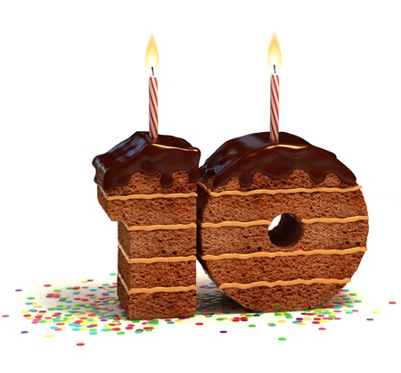 fancy cake: Chocolate birthday cake surrounded by confetti with lit candle for a tenth birthday or anniversary celebration