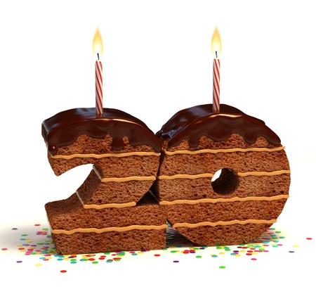 20: Pastel de chocolate de cumplea�os rodeado de confeti con la vela encendida para un cumplea�os o aniversario de la celebraci�n vig�simo