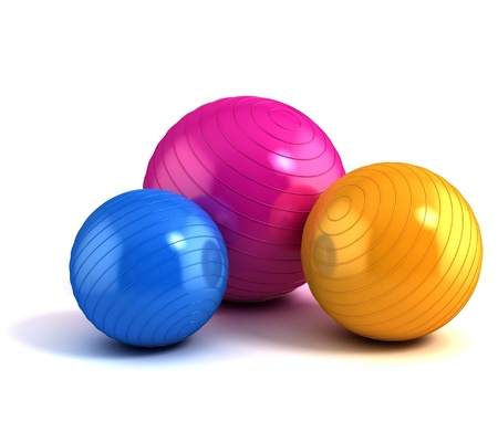gym equipment: colorful fitness balls isolated on white  Stock Photo