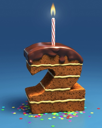 fancy cake: number two shaped birthday cake with candle