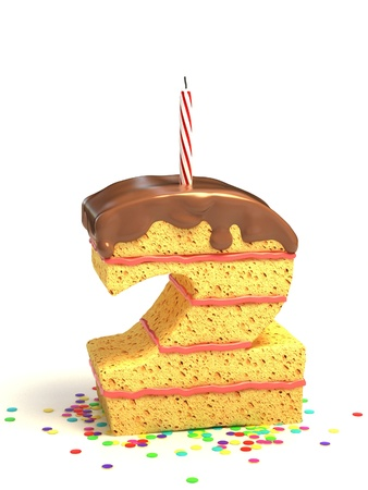 chocolate cakes: number two shaped chocolate birthday cake with lit candle and confetti
