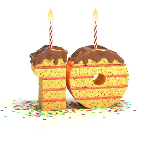 Chocolate birthday cake surrounded by confetti with lit candle for a tenth birthday or anniversary celebration  photo