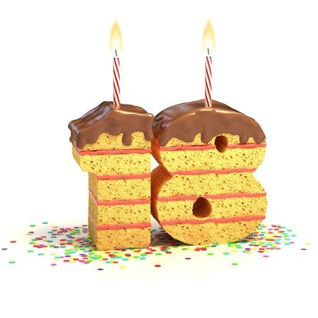 gâteau entouré par des confettis avec bougie allumée pour une dix-huitième anniversaire
