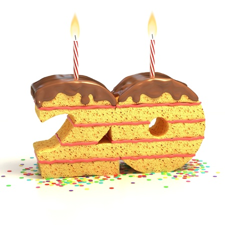 twentieth: Chocolate birthday cake surrounded by confetti with lit candle for a twentieth birthday or anniversary celebration  Stock Photo