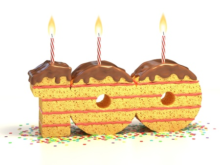 cake birthday: surrounded by confetti with lit candle for a one hundredth birthday or anniversary celebration