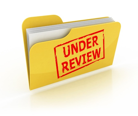 reviewing documents: under review icon  Stock Photo