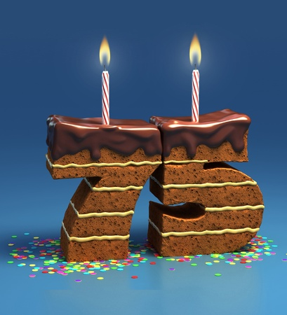 Chocolate birthday cake surrounded by confetti with lit candle for a seventy-fifth birthday or anniversary celebration  photo