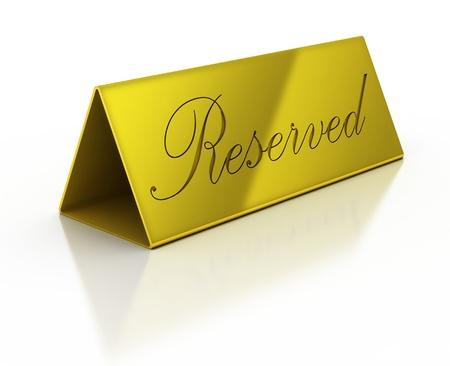 reservacion: se�al de reserva de oro en el fondo blanco Foto de archivo
