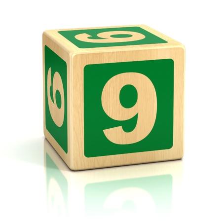 numero nueve: número nueve 9 fuente de bloques de madera Foto de archivo