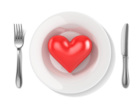 cannibal: 3d red heart on a plate Stock Photo