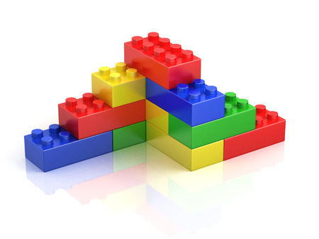yellow lego block: colorful building blocks isolated on white