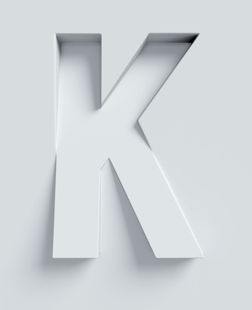 three angled: Letter K slanted 3d font engraved and extruded from the surface Stock Photo