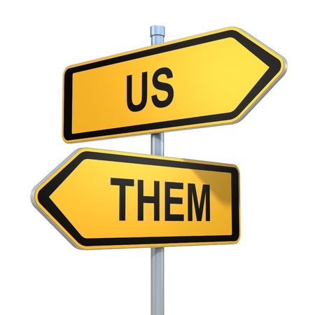 them: us and them road signs pointing in different directions Stock Photo