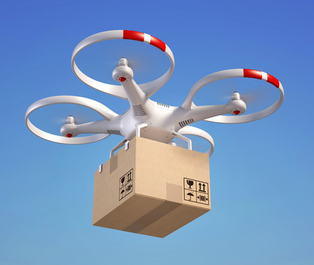shipping by air: Drone with cardboard box in the sky Stock Photo