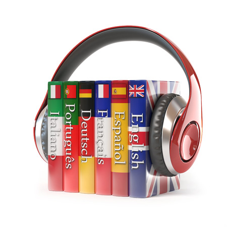 spanish language: dictionaries with headphones, learning foreign language Stock Photo