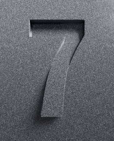 slanted: Number 7 slanted 3d font engraved and extruded Stock Photo