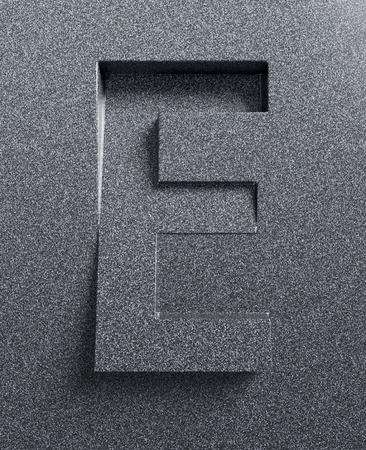 slanted: Letter E slanted 3d font engraved and extruded Stock Photo