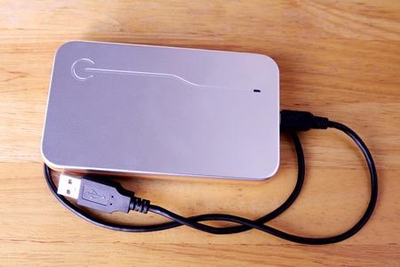 Harddisk external silver and orange color for storage. Stock Photo - 9276093
