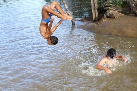childen: childen spring game countryside form thailand.