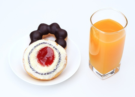 Donut chocolate  strawberry and orange juice for breakfast. photo