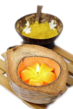 Scented candles spa put in coconut. photo