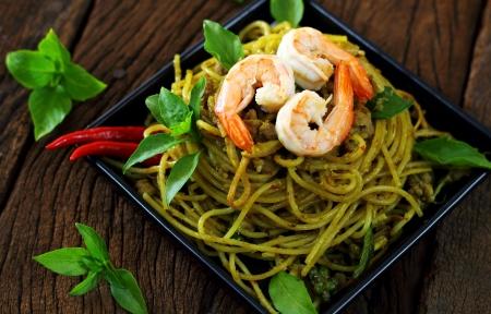 Spaghetti shrimp and pork with green curry. photo