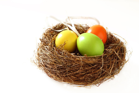 moveable: Easters day  eaggs many color in nest.