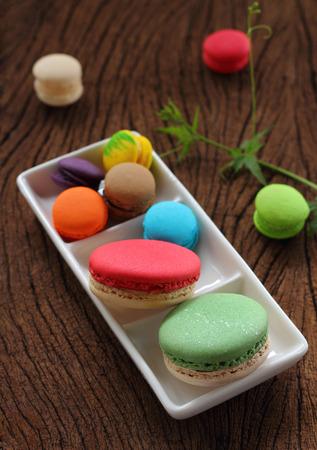 multi color: Macaron multi color size smalls and bigs on brown blackgroun. Stock Photo