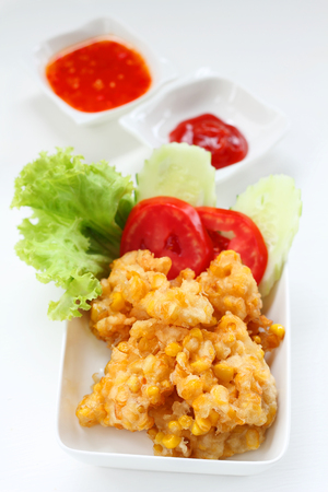 crispy: Crispy fried corn on white background.