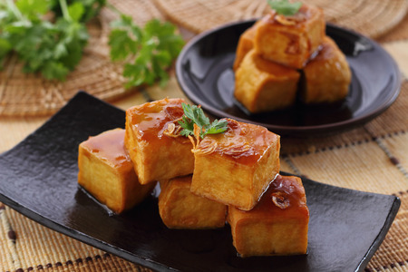 food dish: Sweet and sour  tofu on dish vegetarian food.
