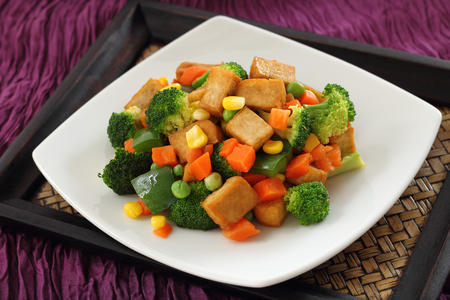 green pea: Fried Tofu with Vegetables broccoli carrot corn and green pea.