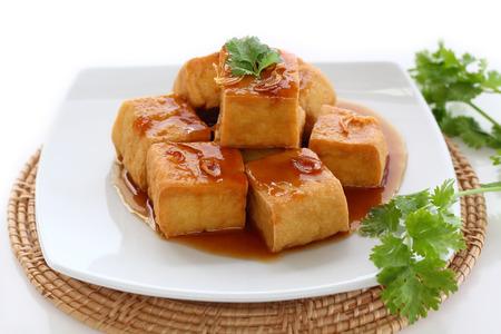 bean curd: Sweet and sour  tofu on dish vegetarian food.