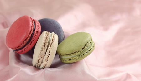 multi color: Macaron is dessert in french,Multi color  on pink blackgroun.